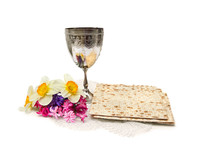 Matzo, Wine, Menorah And Narcissus With Hyacinths For Passover Celebration On White Background With Space For Text