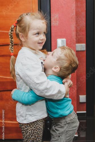 Children hug. Girl hugging a boy