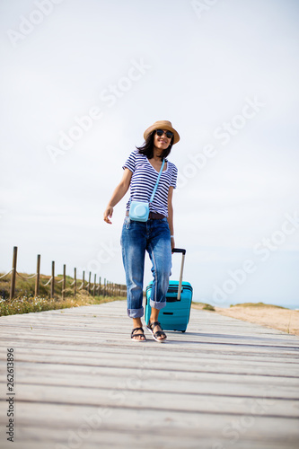 Foto op Canvas Honden Young indian woman traveling around the world