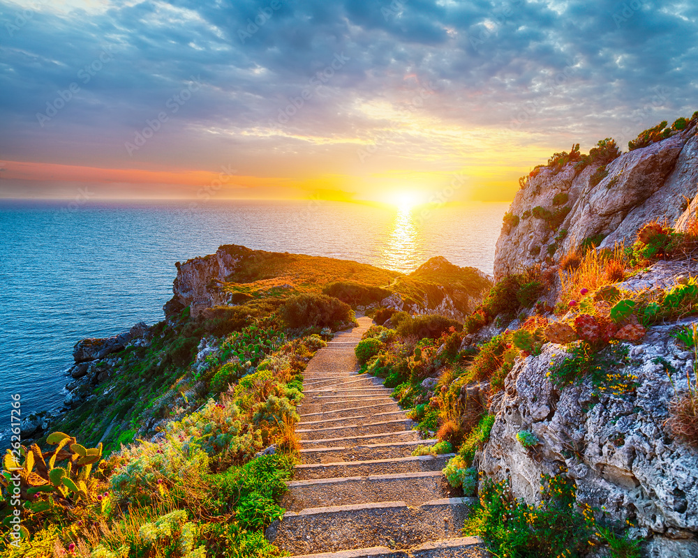 Fototapeta Dramatic spring sunset on the the cape Milazzo panorama of nature reserve Piscina di Venere.