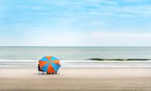Orange And Blue Beach Umbrella On Beautiful Beach With Blue Sky