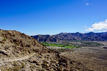 Oasis Of Palm Springs With Mountains And Blue Sky