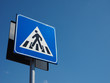 zebra crossing sign over blue sky