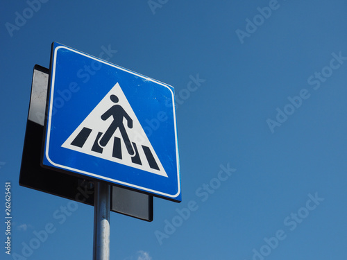 zebra crossing sign over blue sky