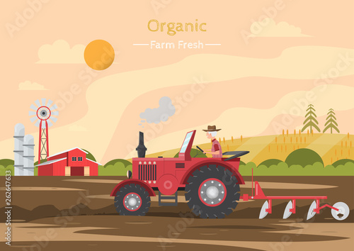 Agricultural work on a field with tractor.