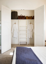 Interior Closet With Robes And...
