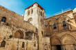 Facade of the Temple of the Holy Sepulcher in Jerusalem. Bright blue sky on a sunny day.