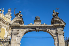 Double Parade Gate With Baroque Pediment And Figures Of Saints To Lviv Greek Catholic Archbishop's Cathedral Of Saint George (Ukr: Sobor Sviatoho Yura, 1760). Lviv, Ukraine.