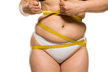 A Fat Woman Measuring Her Belly On White Background