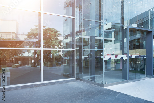 Tableau sur Toile Glass wall facade buildings and clean road reflected on the glass wall