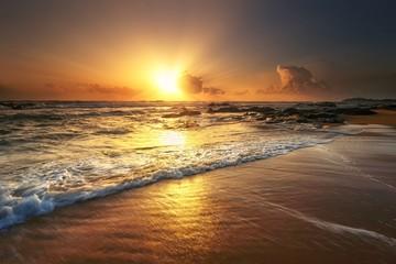 FototapetaBeautiful seascape sunrise view at Kemasik Beach, Terengganu. Natural background..