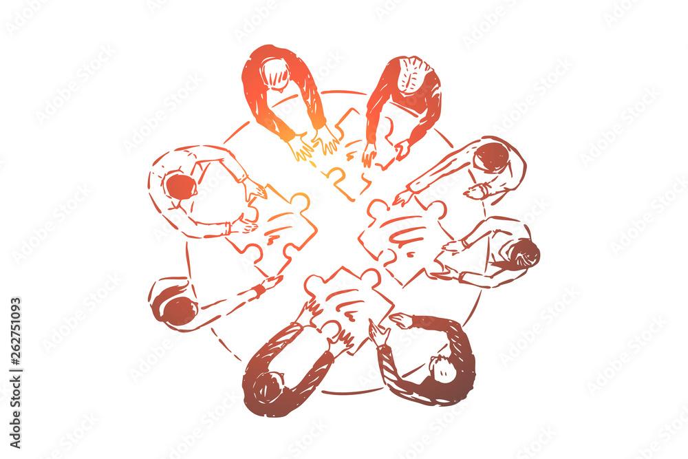 Fototapeta Coworkers assembling puzzle, teamwork, people solving problem, business development