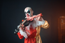 Bloody Clown Plays The Violin With A Human Hand