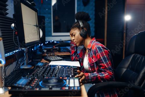 Fotografija Female sound operator in audio recording studio