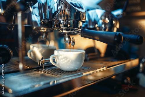 Fotografiet Espresso machine pours fresh black coffee closeup