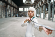 Pretty Anime Style Blonde Woman With Sword