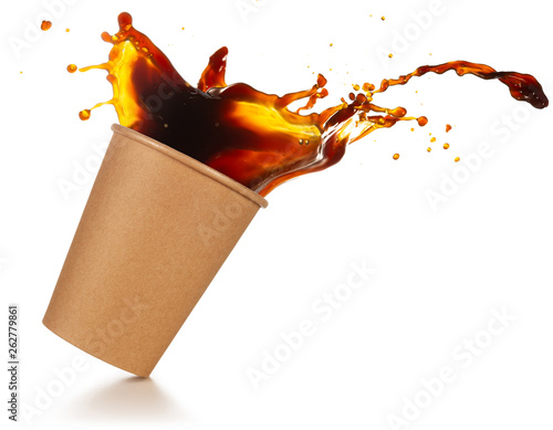 Photo  coffee splashing out of a take-out cup tilted on white background