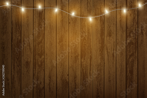 Photo  Garland with light bulbs hanging on a wooden wall