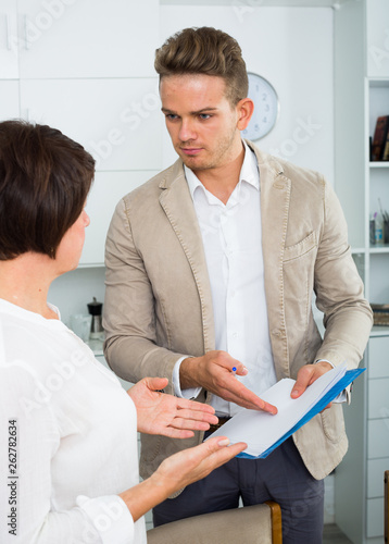 man tries  woman to sign documents Canvas Print