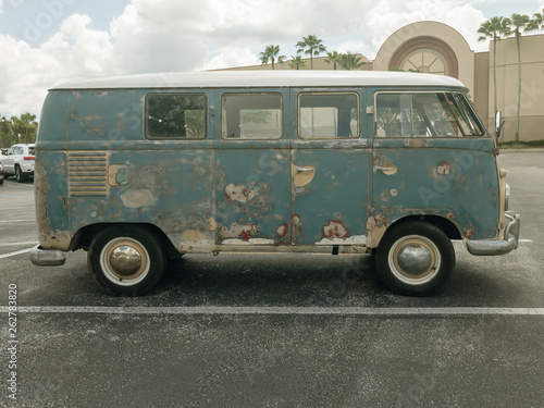 Photo Side View of a Classic Old Rusty Camper Van