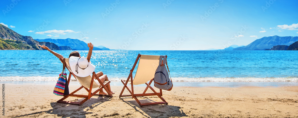 Fototapety, obrazy: Woman Enjoying Sunbathing at Beach