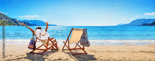 Woman Enjoying Sunbathing at Beach Fototapet