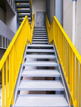 Metal Fire Escape With The Yellow Ladder.