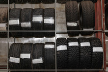 A Large Number Of Car Wheels W...