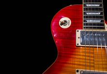 Used , Scratched Sunburst Guitar Close Up On Black Background, Copy Space.