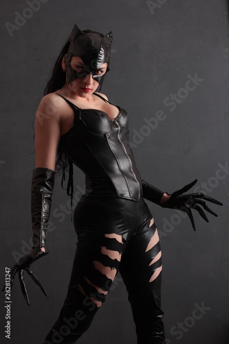 Canvas Attractive woman in leather latex cat costume