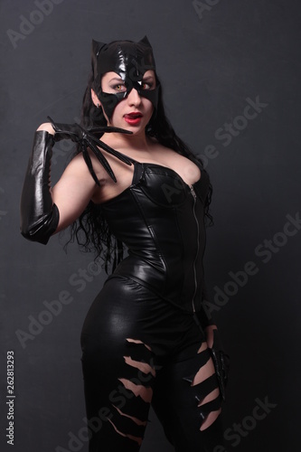 Foto Attractive woman in leather latex cat costume