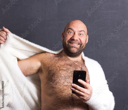 Bald brutal man in white fur coat. Slika na platnu