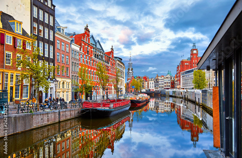 Obraz Channel in Amsterdam Netherlands houses river Amstel landmark old european city spring landscape. - fototapety do salonu