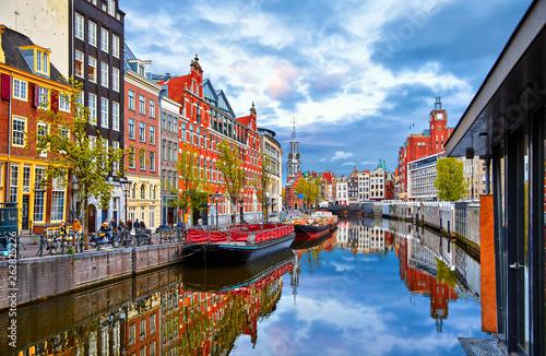 Canvas Prints Amsterdam Channel in Amsterdam Netherlands houses river Amstel landmark old european city spring landscape.