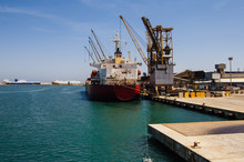 Ship In A Container Terminal By The Sea