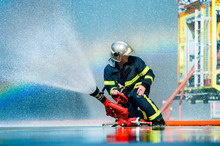 Anonymous Fireman Fighting Fire With Water
