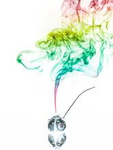 Jar With Herbs Emitting Smoke