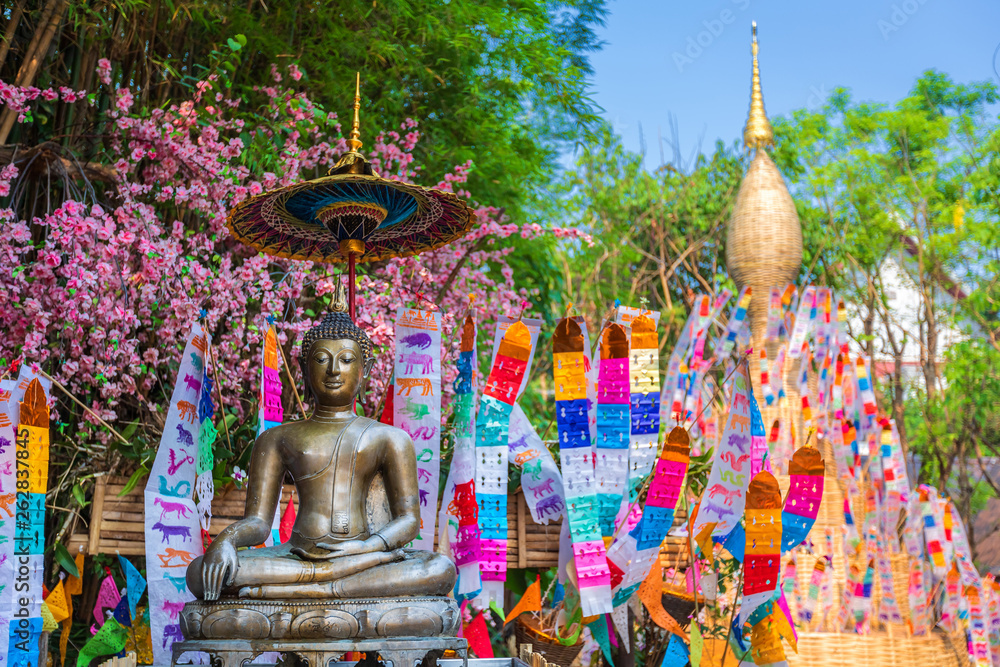 Fototapety, obrazy: Prayer flags tung Hang with umbrella or Northern traditional flag hang on sand pagoda in the Phan Tao temple for Songkran Festival is celebrated in a traditional New Year's Day in Chiang Mai,Thailand