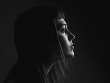 Pensive Woman In Profile. Black And White