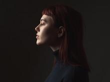 Attractive Young Woman In Studio. Profile.
