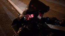 Man Putting Key Into Ignition Starting Motorcycle Engine Start Night Lights