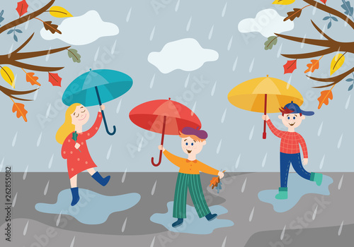 Cheerful children playing under umbrella in rainy weather outdoors in autumn park or garden.