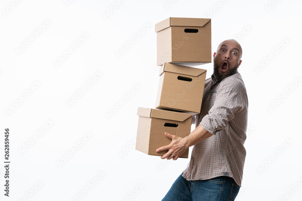 Fototapety, obrazy: Young man carrying and dropping his stack of moving boxes