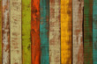 Wood texture. Fence from old multi-colored boards