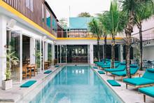 Sunbeds Around Swimming Pool In Stylish Tropical Beach Club