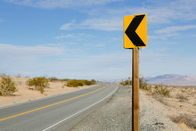 Turn Ahead Sign Along Remote Desert Road