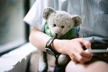Boy With A Worn Teddy Bear After School