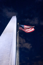 Washington Monument A Radiant Bright White Reaching High Into Sky With American Flag