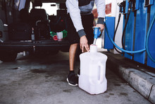 Man Fills Up Jerry Can