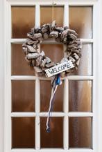 Wreath With Sign Welcome On Door
